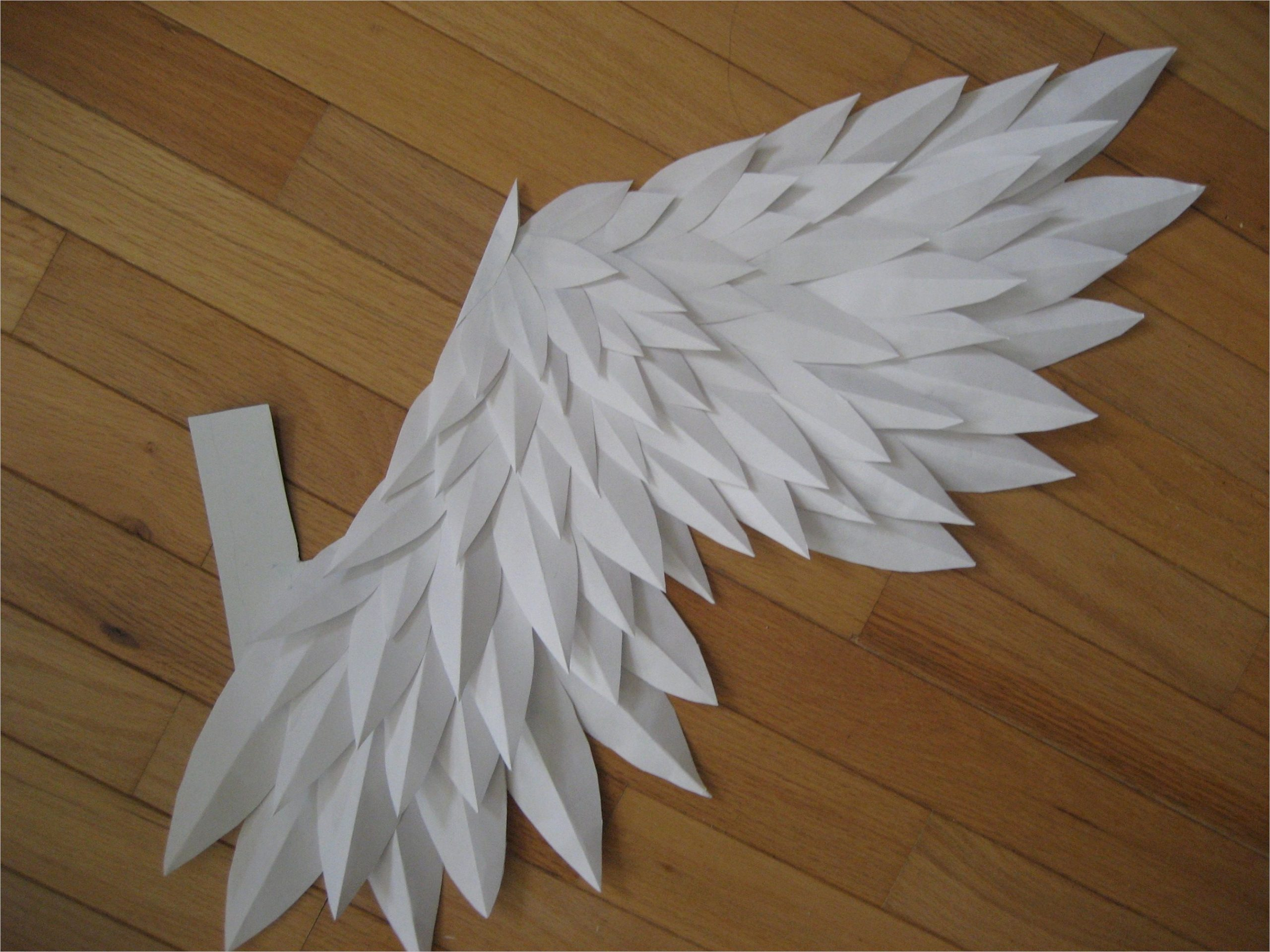the origami pigeon wings crafted from clove paper