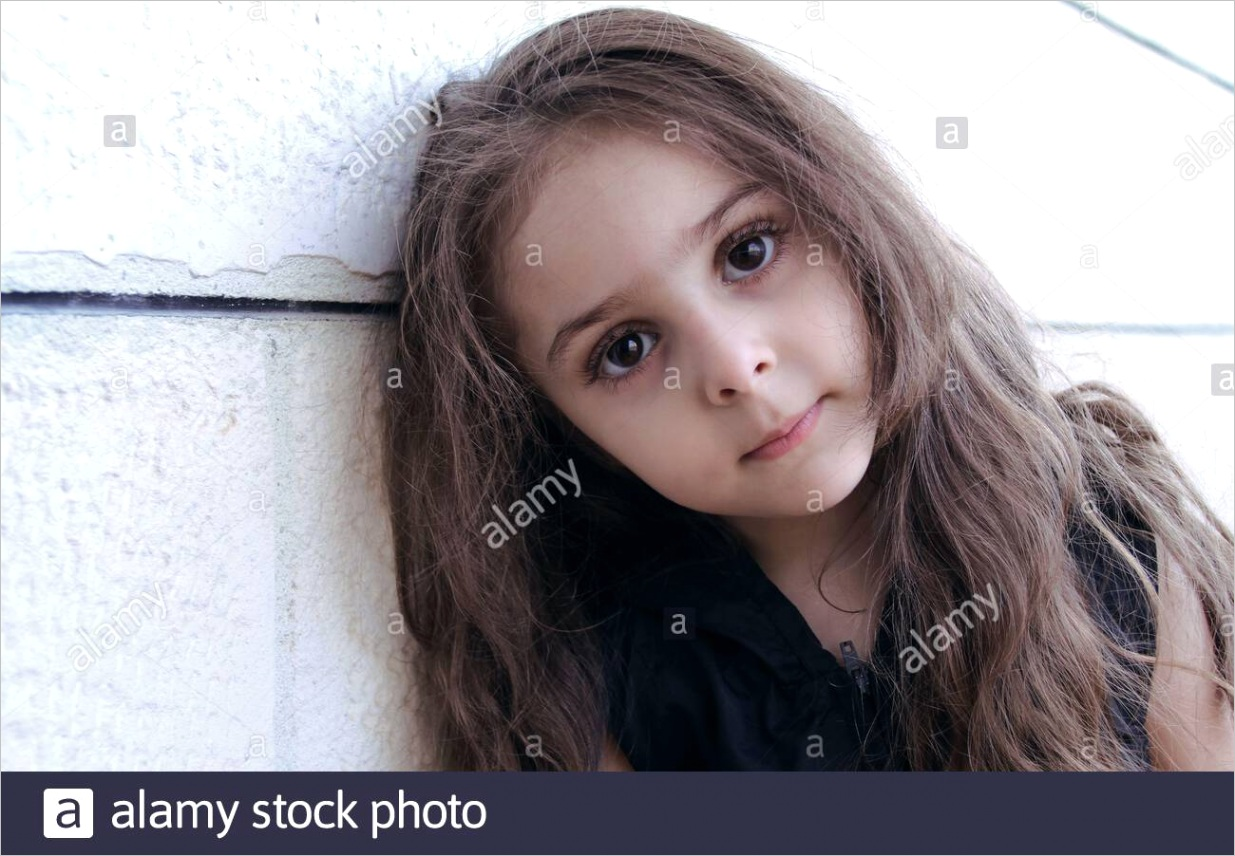 portrait of a little cute girl with big eyes leaning on wall image ml