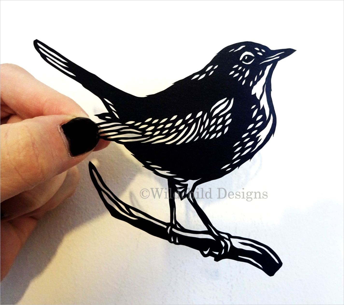 nightingale on branch paper cutting