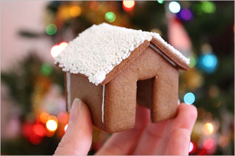 a gingerbread house that perches on the rim of your mug